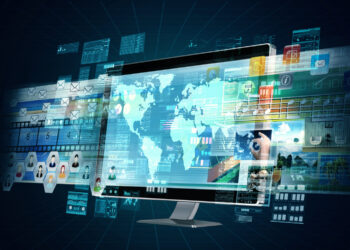 Ecran geant d'un ordinateur avec une carte du monde - et activites a l'international